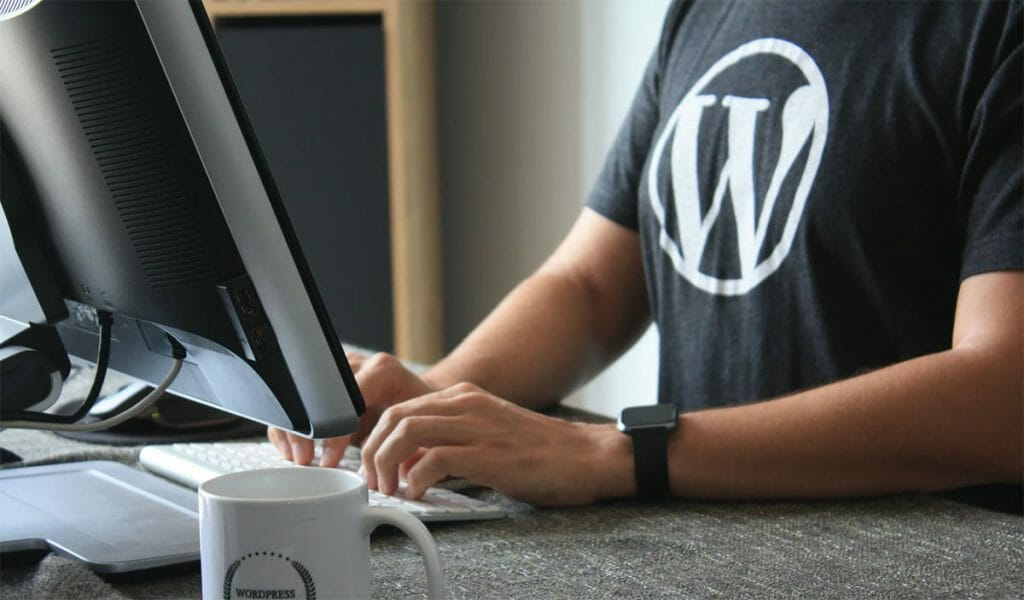 Writing a post on WordPress, wearing a WordPress shirt